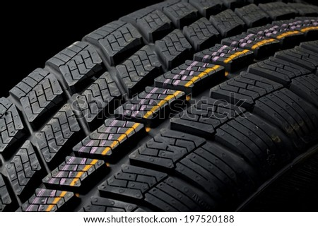 Winter tyre closeup, dark backgroud - stock photo
