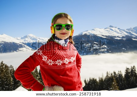 Winter vacation - girl enjoying winter - stock photo