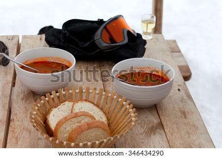 Winter vacation. Lunch at Georgia ski resort, kharcho and chacha. - stock photo