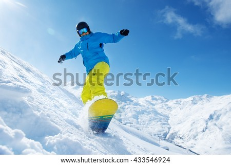 Winter vacation - man snowboarding on a cold sunny day