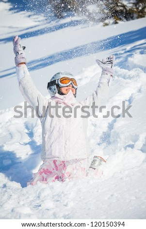Winter vacation, ski - closeup happy skier girl playing in snow - stock photo
