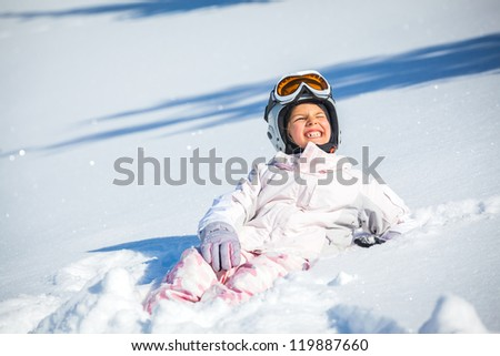 Winter vacation, ski - happy skier girl playing in snow - stock photo