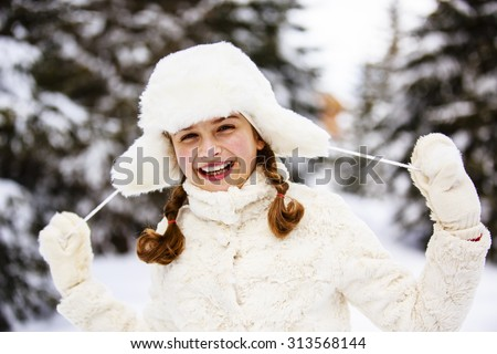 Winter vacation, snow - girl enjoying winter - stock photo