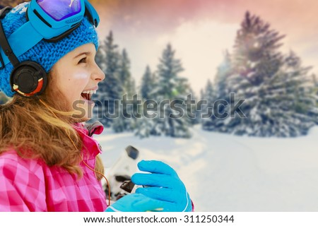Winter vacation, snow, skier - girl enjoying winter - stock photo