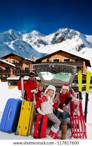 Winter vacations, ski, travel - family with baggage ready for the travel for ski vacations - stock photo
