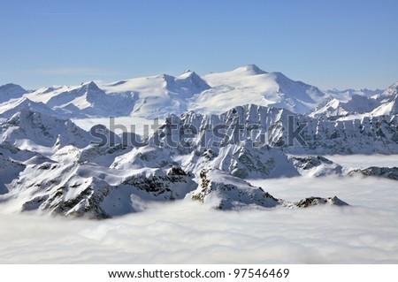 Winter view from Kitzsteinhorn peak ski resort, Austrian Alps - stock photo
