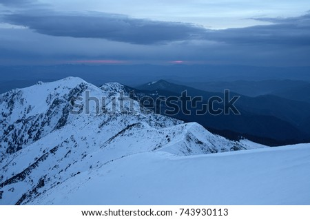 Winter view. Mountain landscape with the setting sun