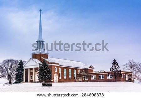 Winter view of a church in rural York County, Pennsylvania. - stock photo