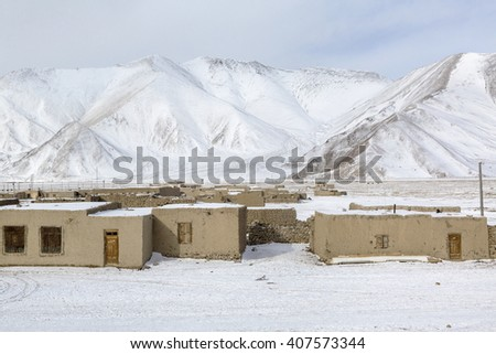 Winter view of a village in the high mountains of the Pamirs - stock photo