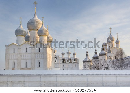 Winter view of Assumption Cathedral with belfry, Holy Gates and the Resurrection Church with belfry on the cathedral Square of the Kremlin of the Rostov Veliky town and part of the Golden Ring - stock photo