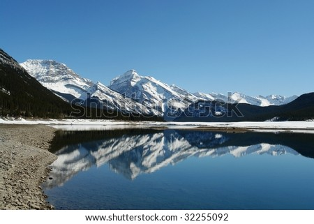 Winter view of canadian rockies and lake in kananaskis, Alberta, Canada