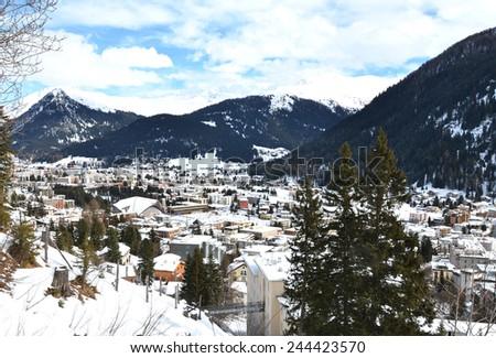 Winter view of Davos, famous Swiss skiing resort  - stock photo