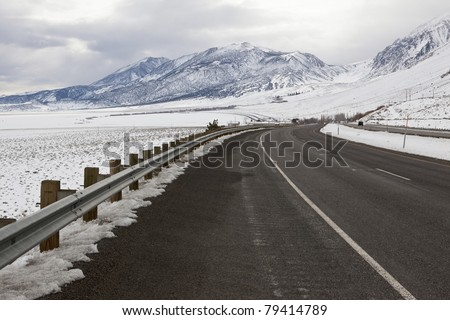 Winter view of Highway 395 along Sierra Nevada mountains in eastern California - stock photo