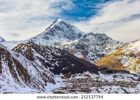 Winter view of Kazbek (Kazbegi) mountain, Georgia. - stock photo