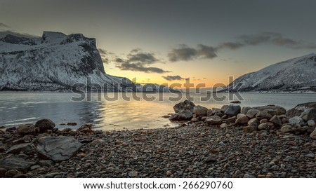 Winter view to sunset over beautiful fjord, Troms county - Norway - stock photo