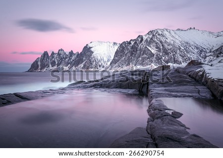 Winter view to the Steinfjord on Senja Island in the sunset, Troms county (long exposure) - Norway - stock photo