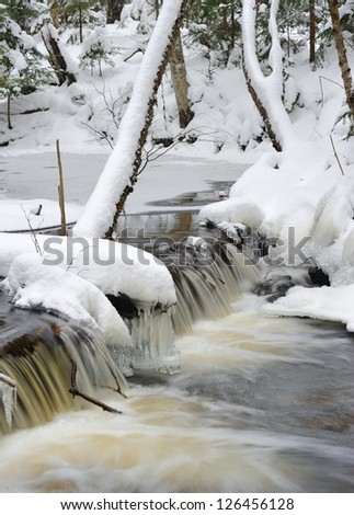 Winter waterfall in Michigan's Pictured Rocks National Lakeshore - stock photo