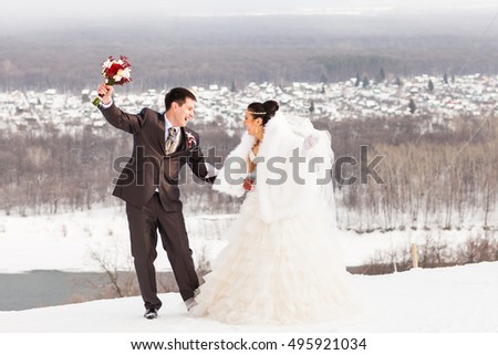 Winter wedding. Beautiful young couple bride and groom