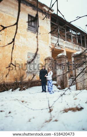 Winter wedding. Beautiful young couple in the old