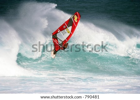 Winter windsurfer in high surf in Maui, Hawaii