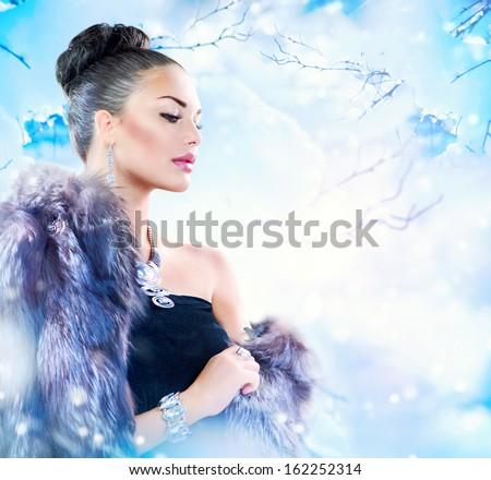 Winter Woman in Luxury Fur Coat. Beauty Fashion Model Girl in Blue Fox Fur Coat. Beautiful Luxury Winter Lady - stock photo