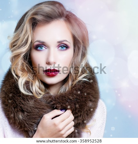 Winter Woman in Luxury Fur Coat. Beauty Fashion Model Girl in Blue Fox Fur Coat. Perfect Makeup, accessories and hairstyle. Beautiful Luxury Winter Lady - stock photo