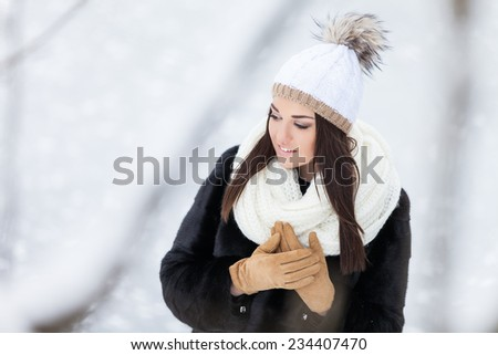 Winter woman in snow outside in nature. Portrait closeup outdoors in snow.