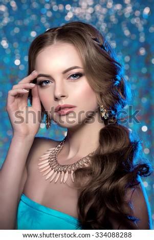 Winter woman model gorgeous beauty makeup stylish hairstyle Young girl background bokeh Lady make up Mascara long lashes lipstick lips eye shadow shiny hair manicure nail polish Products Treatment - stock photo