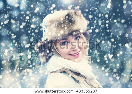 Winter Woman on Snow Winter Background