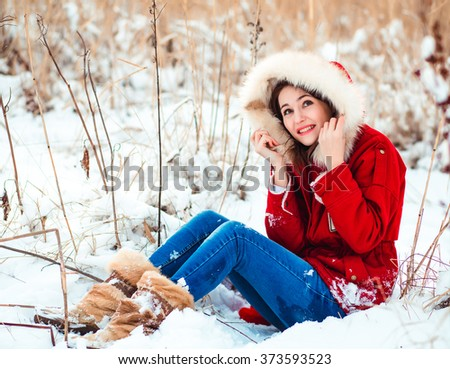 winter woman playing with snow