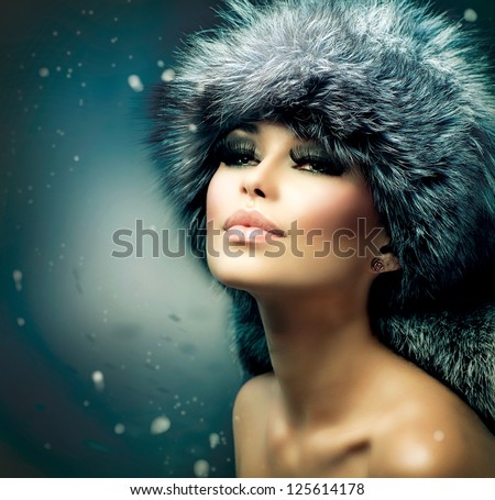 Winter Woman Portrait. Beauty Model Girl. Fur Fashion. Beautiful Girl in Fur Hat - stock photo