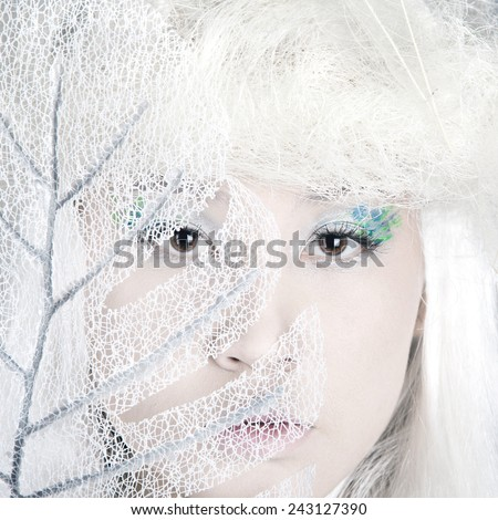 Winter Woman Portrait. Snow. Beauty Fashion Model Girl with White Hair closeup. Make up. Asia model face. Close up - stock photo