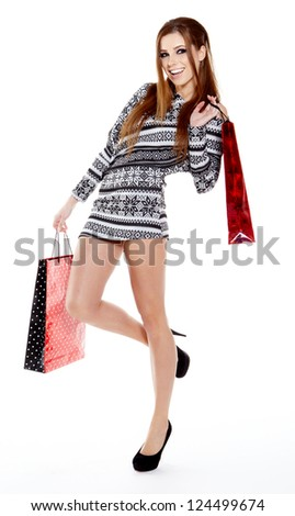 Winter woman with shopping bags over grey