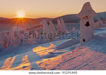 Winter wonderland during the colorful sunrise. - stock photo