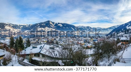 Winter wonderland in the Alps with beautiful mountain landscape and famous Zeller Lake in Zell am See, Salzburger Land, Austria - stock photo
