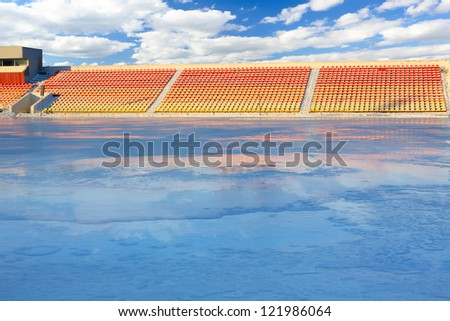 Winter work on filling the stadium with water. Skating