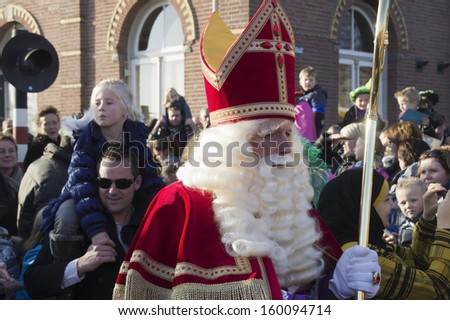 WINTERSWIJK, HOLLAND - 12 NOVEMBER 2011: Santa Claus on his horse on Santa Claus parade on 12 November  2011 in Winterswijk, Holland. - stock photo