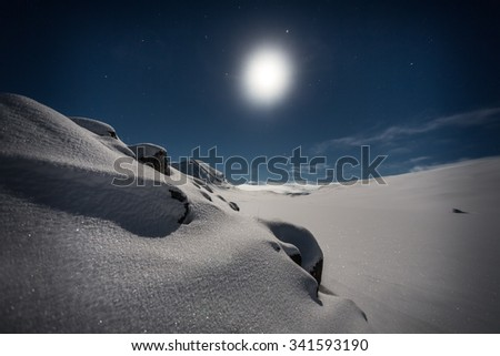 Wintertime under the Moon in Northern Sweden  - stock photo