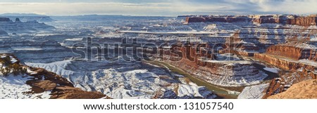 Wintry view of a gooseneck bend in the Colorado River from the overlook in Dead Horse Point State Park Utah. - stock photo