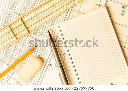 Wipe the slate clean, planning engineers and architectural works. In yellow tone - stock photo