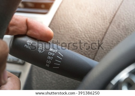 Wipers control. Modern car interior detail. adjusting speed of screen wipers in car