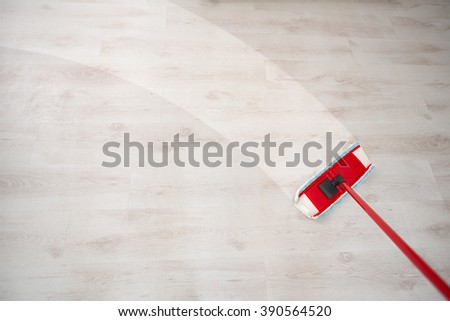 Wiping floor during spring cleaning  - stock photo