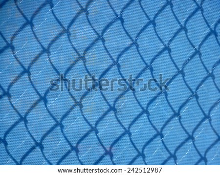 Wire and blue mesh fencing.