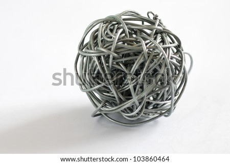 wire ball on white background - Depth of field close up photo - stock photo