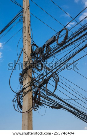 Wire electric in pole it messy and chaotic. - stock photo