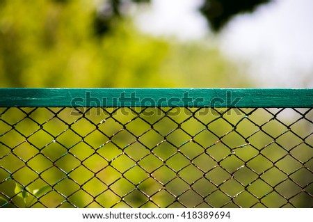 Wire fence with green grass on background - stock photo