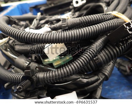 stock photo wire harness of car in automotive industrial 696631537 wiring harness for car stock images, royalty free images & vectors Wire Harness Assembly at bakdesigns.co