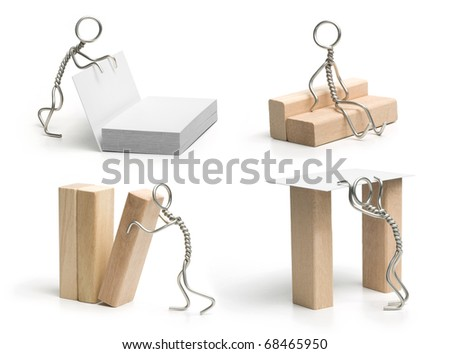 Wire man with the cards & wooden bricks. On the white background. Set of 4. - stock photo