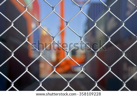 Wire mesh fence enclosing the container yard