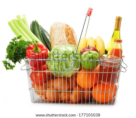 Wire shopping basket with groceries isolated on white - stock photo